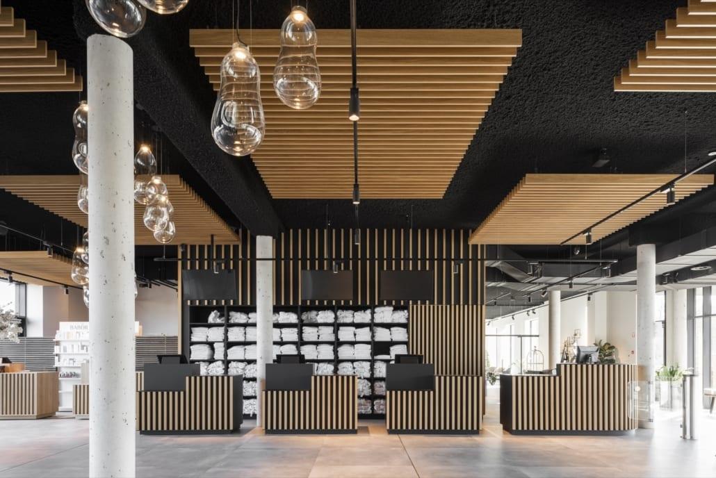 Mur acoustique et lattes de plafond chez Waer Waters