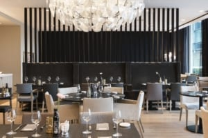Acoustic claustra wall as a divider to guarantee privacy in the restaurant