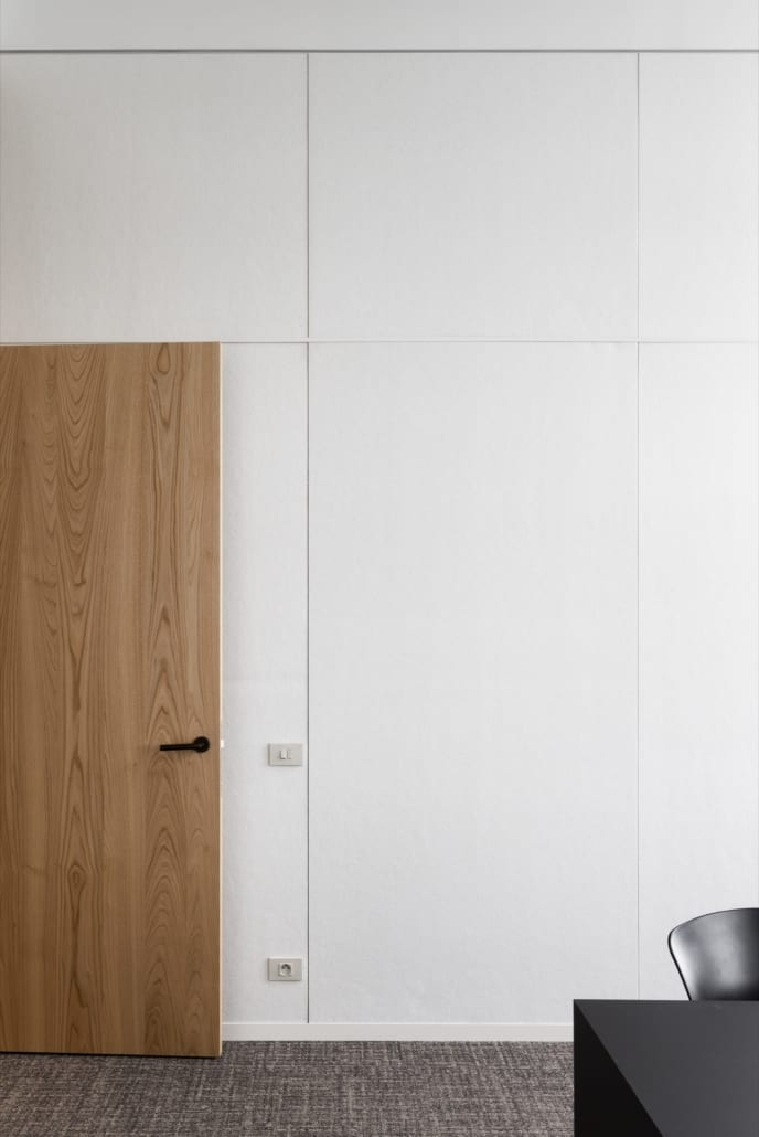 Portrait of white acoustic wall panels for a landscape office