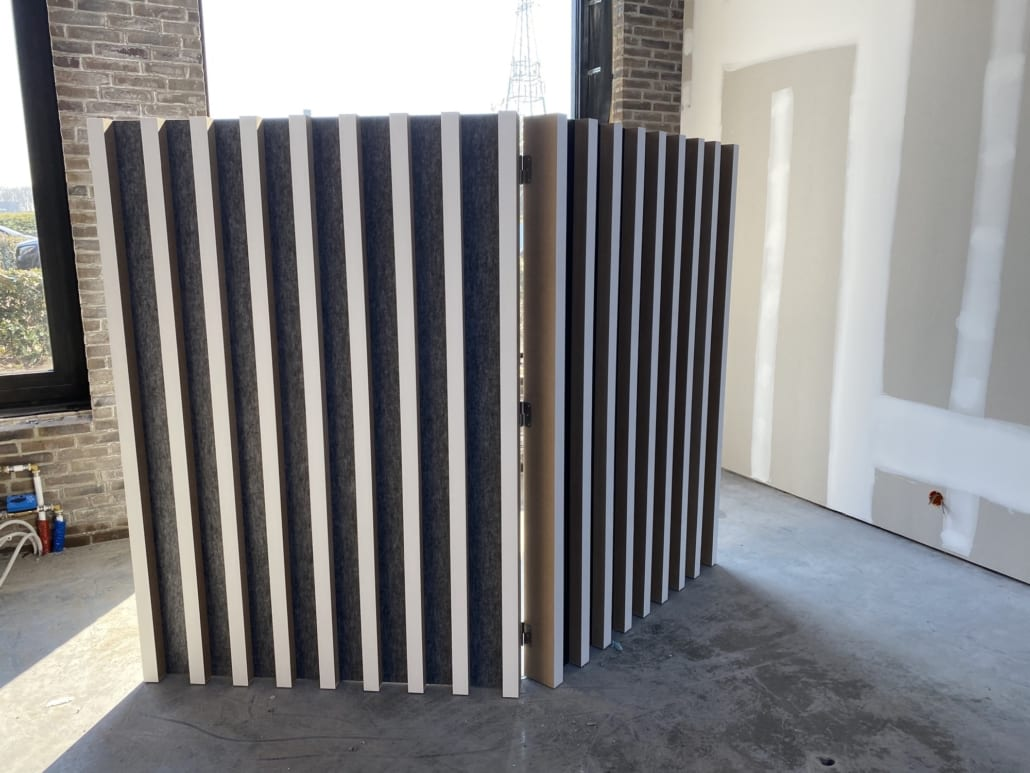 Detail acoustic divider finished with slats
