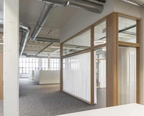A sleek and modern office with wooden elements for DLPA Advocaten